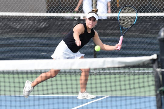 Abilene High's Kaitlyn Strain reacts to a serve during the No. 1 girls doubles match against North Crowley in the Region I-6A bi-district playoff on Tuesday. Strain and partner Ruth Hill won 6-0, 6-0 as the Eagles swept the seven doubles matches.