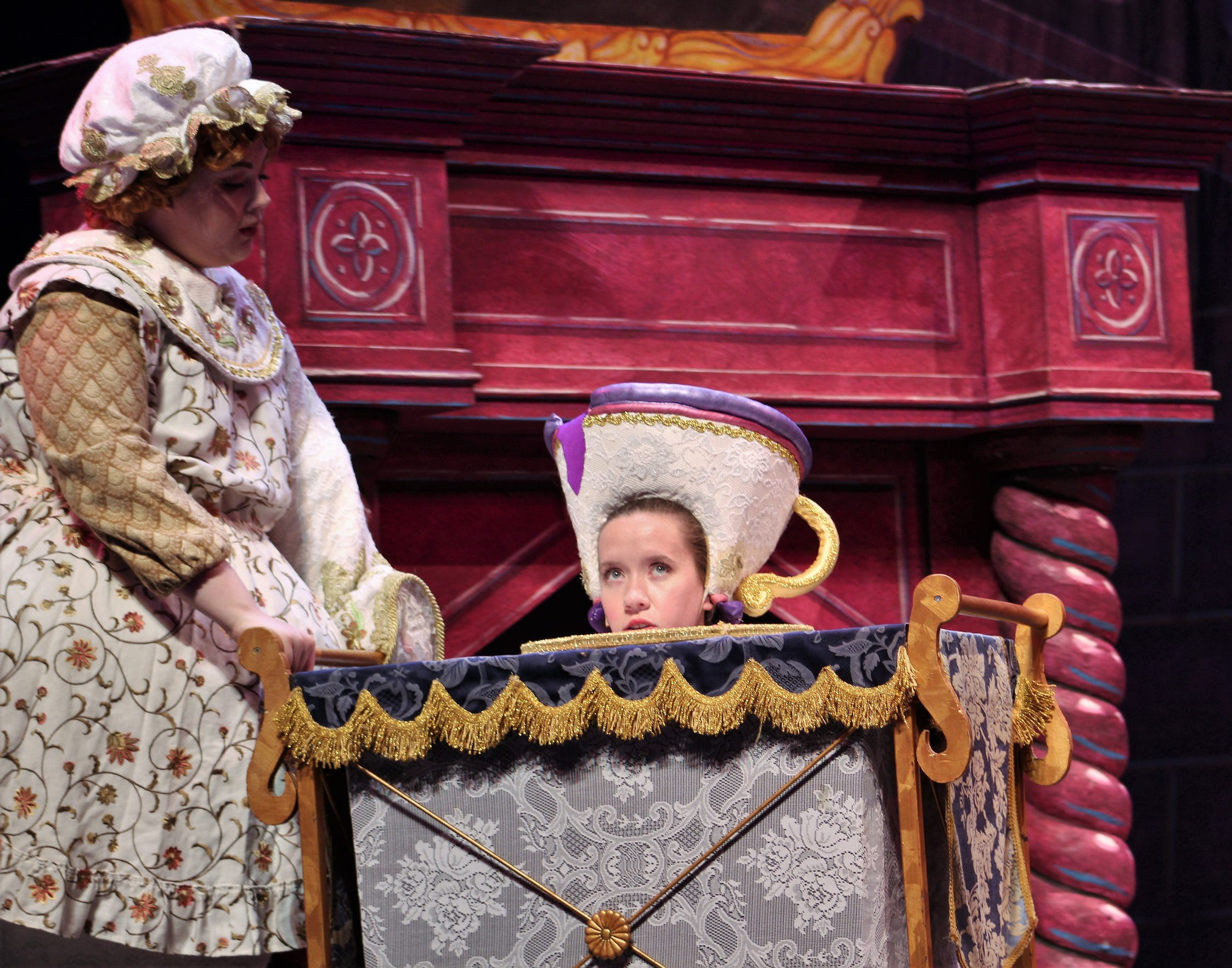 Chip (Carly Carroll) gives a peek next to Mrs. Potts (Nora Vellis).