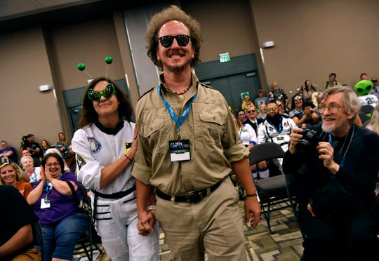 Bill and Cat Genzer step forward after winning the cosplay contest at AlienCon Dallas Oct. 5. Bill's costume came naturally to him, his wife said people frequently remark on his resemblance to Ancient Aliens personality Giorgio Tsoukalos.