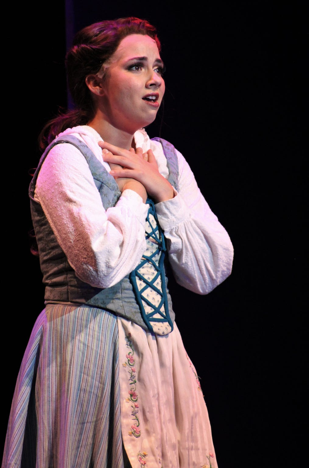 """Lauren McDonald is Belle, who is being wooed by Gaston and then finds herself detained by a Beast in his castle in Abilene Christian University's production of """"Beauty and the Best,"""" performed as the 2019 homecoming musical."""