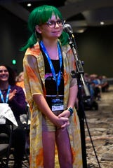 Brilee Elliott, 10, asks a question of Giorgio Tsoukalos and the rest of a panel at AlienCon Dallas Oct. 6. Brilee said she was a devoted fan of the History channel television show Ancient Aliens.