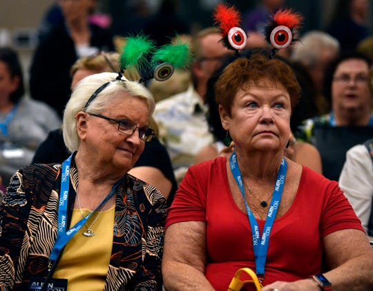 Marie Lutzinger, left and Deb Hodges wait for a presentation to begin on government disclosure of alien contact during AlienCon Dallas Oct. 5.