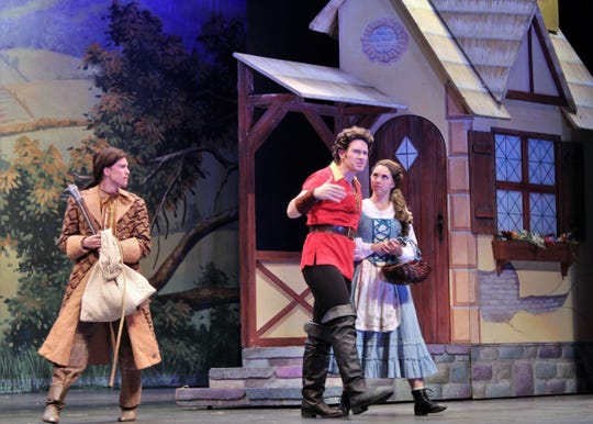 "Belle (Lauren McDonald) gets an earful from Gaston (Griffin Jones), who is wooing the town beauty, as Lefou (Easton Orr) watches, in this rehearsal scene from Abilene Christian University's ""Beauty and the Beast,"" which will be performed Friday and Saturday evenings and Sunday afternoon at the Abilene Convention Center. Oct. 14 2019"