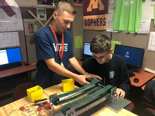 Caleb Stone, left, and Jesse Epps, both juniors at the Abilene Independent School District's Academy of Technology, Engineering, Math and Science, build a transfer system (conveyor belt) in class Tuesday. ATEMS will relocate to the school district's The LIFT beginning in the 2021-22 school year.