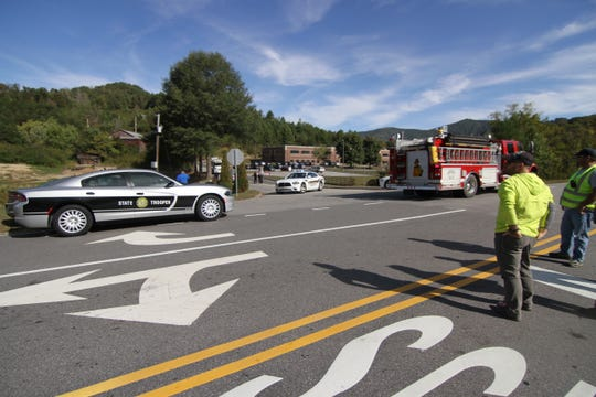 Fire trucks and squad cars blocked access to Madison Middle School and Brush Creek Elementary after a bomb threat forced the evacuation of the two schools Oct. 15.