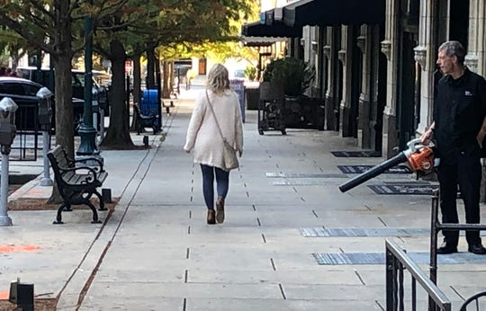 Businesses do sometimes clear the sidewalks with blowers, but the city asks residents and business owners not to blow leaves and other debris into the streets.