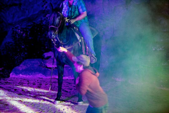 """Farley Norman, as Ichabod Crane, comes face-to-face with Mark Hoyle on a black horse as the Headless Horseman as they rehearse for """"The Sleepy Hollow Experience"""" at the Cherokee Mountainside Theatre on Oct. 14, 2019. The show opens with the adaptation of the Halloween story on Oct. 17, 2019."""