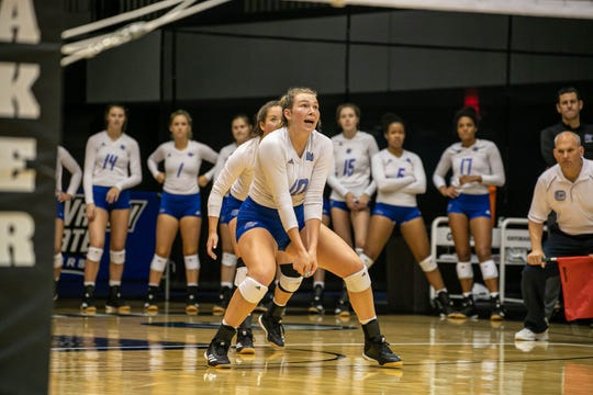Former Lakeview standout Karlie Kucharczyk, left, is among the leaders already in several categories as a freshman on the Grand Valley State University volleyball team.