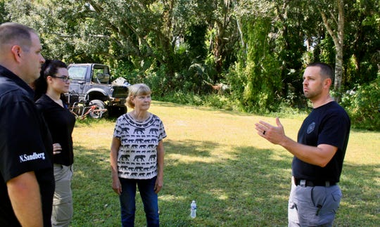 Palm Bay Police Sgt. Jeff Spears (right) discusses Tuesday's dig with Brandy's mother Debbie Rogge (center), private investigator intern Rachael Bassett and Private Investigator Nic Sandberg.