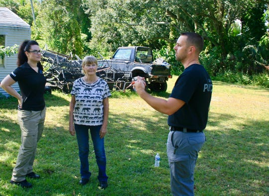 Palm Bay Police Sgt. Jeff Spears (right) discusses Tuesday's dig with Brandy's mother Debbie Rogge (center) and private investigator intern Rachael Bassett.