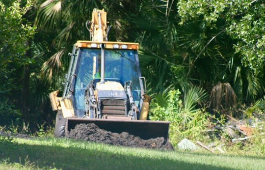 Heavy machinery was brought in by Palm Bay's Public Works Department to take part in the dig for missing firefighter Brandy Hal's remains.