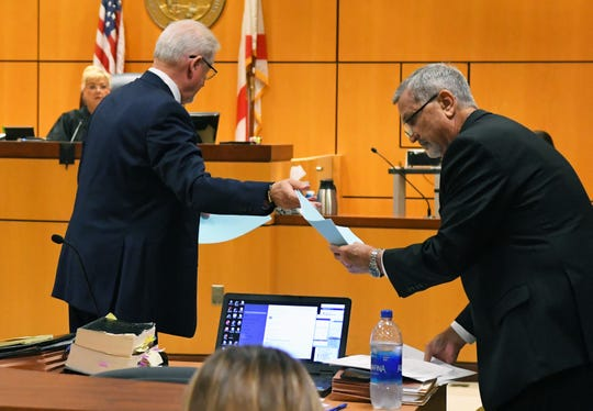 Defense attorney Greg Eisenmenger and Assistant State Attorney Michael Hill. Eric Antosia, a Sebastian police officer, was charged with animal cruelty after Diesel, his K-9 partner, was left in his police vehicle, and died from the heat. The trial is being held in the Viera courtroom of Judge Kelly Ingram.