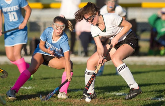 South Burlington's Sam Crane, left, defends during a high school field hockey game in South Burlington on Tuesday, Oct. 15, 2019.