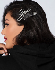 The Selena signature/rose hair clip set is available for $24 at Selena-official.com.