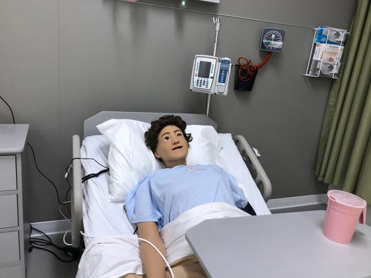A dummy inside a medical simulation room at the Joint Health Sciences Center can mimic patient behavior and help students learn before they're ready for a clinical setting.