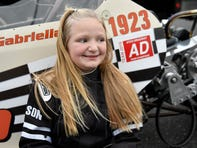 Gabbie Bucco prepares to run her dragster at Atco Dragway on Friday night. Bucco is 8 years old and recently earned her NHRA license.