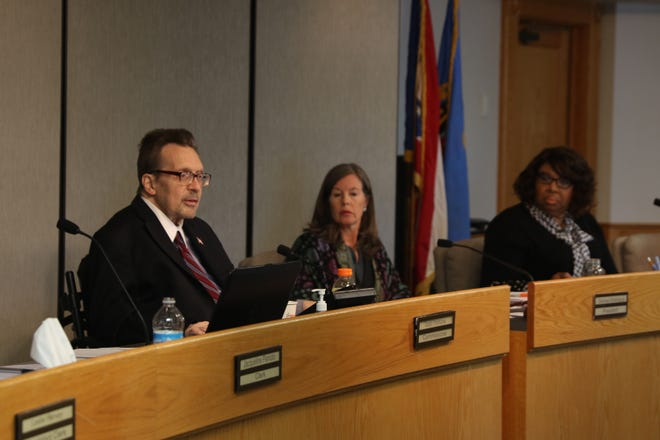 Todd Portune, left, Denise Driehaus and Stephanie Dumas, before voting to increase sales tax.
