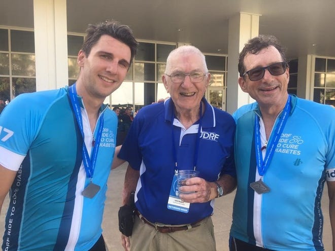 John Hughes is 92 years old and will participate in JDRF's Death Valley Ride to Cure Diabetes. He is pictured here, center, with his grandson Jordan, left, and son Bart, right.