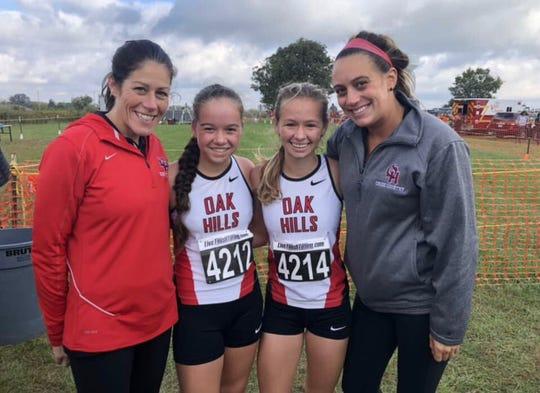 Oak Hills head girls cross country coach Shellie Hageman (far left) poses with runners Megan John, Emma Lucas and assistant cross country coach Danielle Mercer