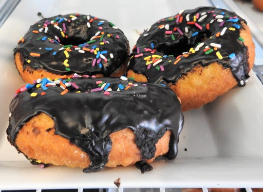 Chocolate iced doughnuts with sprinkles are just one of the confections available fresh daily at Daily Bread Bakery and Cafe.