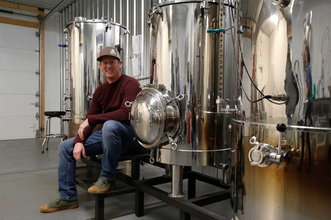 Brewer and Indianola native Doug Gaumer poses with the two-barrell tank system. The West Hill Brewery is scheduled to open Nov. 2.