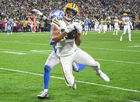Oct 14, 2019; Green Bay, WI, USA; Green Bay Packers wide receiver Allen Lazard (13) catches a touchdown pass against Detroit Lions cornerback Justin Coleman (27) in the fourth quarter at Lambeau Field. Mandatory Credit: Benny Sieu-USA TODAY Sports