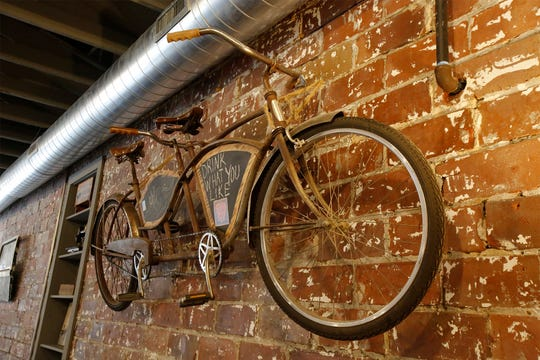 A bicycle-built-for-two is part of the decor at the West Hill Brewery. The West Hill Brewery is scheduled to open Nov. 2.
