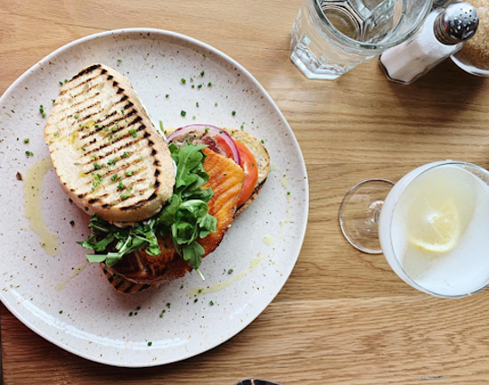 The salmon club sandwich with a gimlet cocktail from St. Kilda at the Temple for Performing Arts.