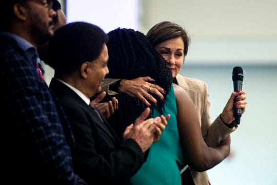 Governor Kim Reynolds hugs Betty Andrews, president of the Iowa-Nebraska NAACP, while announcing the Governor's FOCUS committee on criminal justice reform during the 7th annual Iowa summit on justice and disparities on Tuesday, Oct. 15, 2019, in Ankeny. Lt. Governor Adam Gregg will lead the committee.