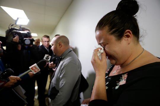 Sarah Jones, mother of Bobby Reyes, is in tears as her attorney William C. Amadeo talks to the media after Judge David Swartz dismisses their case against University of Michigan C.S. Mott Children's hospital asking for stay for lack of jurisdiction on Tuesday, Oct. 15, 2019.