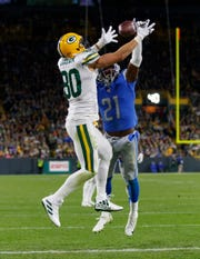 Oct 14, 2019; Green Bay, WI, USA; Detroit Lions safety Tracy Walker (21) breaks up the pass intended for Green Bay Packers tight end Jimmy Graham (80) during the fourth quarter at Lambeau Field. Mandatory Credit: Jeff Hanisch-USA TODAY Sports