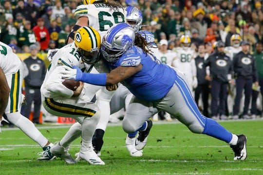 Green Bay Packers quarterback Aaron Rodgers is sacked by Detroit Lions defensive tackle Damon Harrison during the second half Monday, Oct. 14, 2019, in Green Bay, Wis.