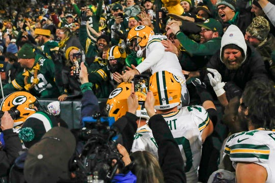 Green Bay Packers kicker Mason Crosby celebrates kicking the winning field goal by jumping in the stands after defeating the Detroit Lions, 23-22, Monday, Oct. 14, 2019, in Green Bay, Wis.