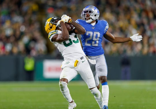 Green Bay Packers receiver Marquez Valdes-Scantling catches a pass over Detroit Lions cornerback Rashaan Melvin during the fourth quarter at Lambeau Field, Oct. 14, 2019.