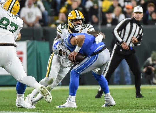 Green Bay Packers linebacker Za'Darius Smith sacks Detroit Lions quarterback Matthew Stafford in the second quarter at Lambeau Field in Green Bay, Wis., Oct. 14, 2019.