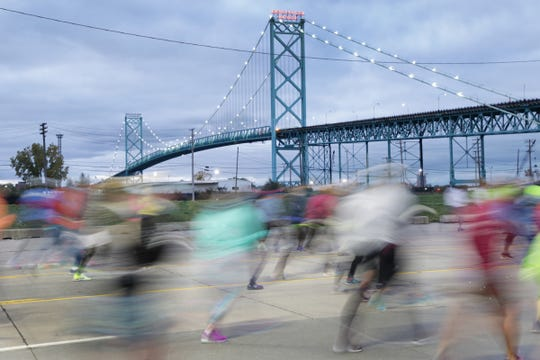 Runners make their way to the Ambassador Bridge on Fort Street during the 41st Annual Detroit Free Press/Chemical Bank Marathon in Detroit on Sunday, Oct. 21, 2018.