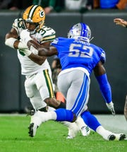 Green Bay Packers running back Aaron Jones escapes the grasp of Detroit Lions linebacker Christian Jones at Lambeau Field in Green Bay, Wis., Oct. 14, 2019.
