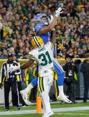 Green Bay Packers safety Adrian Amos contests a pass intended for Detroit Lions tight end T.J. Hockenson during the second quarter at Lambeau Field in Green Bay, Wis., Oct. 14, 2019.