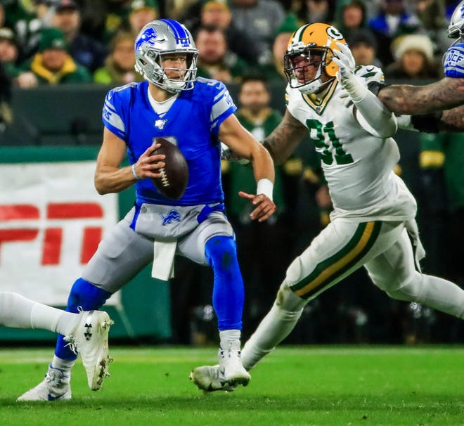 Detroit Lions quarterback Matthew Stafford scrambles away from a Green Bay Packers defender at Lambeau Field in Green Bay, Wis., Oct. 14, 2019.