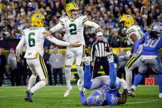 Mason Crosby (2) celebrates making the winning field goal on the final play against the Lions on Oct. 14.