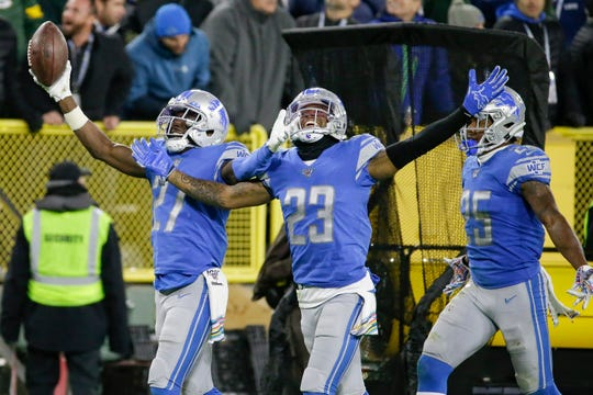 Detroit Lions cornerback Justin Coleman (27) celebrates an interception against the Green Bay Packers with teammates Darius Slay (23) and Will Harris (25) during the second half Monday, Oct. 14, 2019, in Green Bay, Wis.