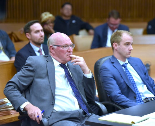 Wayne County Assistant Prosecutors Tom Dawson, left, and Paul DeCorte, listen to witness testimony.
