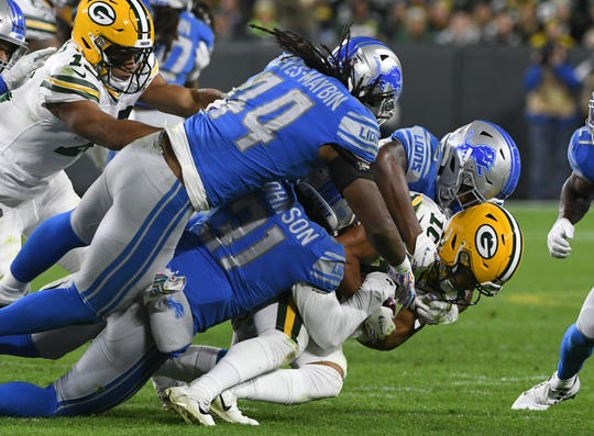 The Packers' Darrius Shepherd is brought down by the Lions defense in the third quarter Monday night at Lambeau Field in Green Bay, Wisconsin.