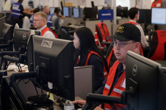 Pacific Gas & Electric employees work in the PG&E Emergency Operations Center in San Francisco on Oct. 10.