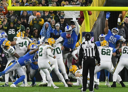 Packers kicker Mason Crosby puts through a 23-yard field goal to win the game, 23-22.