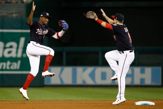 Washington Nationals' Victor Robles and Brian Dozier celebrate after Game 3.
