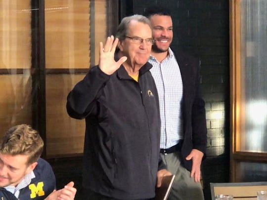 Former Michigan head football coach Lloyd Carr acknowledges those in attendance Tuesday at Zingerman's Roadhouse in Ann Arbor.