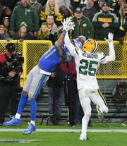Lions receiver Marvin Jones Jr. can't bring in a reception with the Packers' Will Redmond swatting the ball away in the fourth quarter.