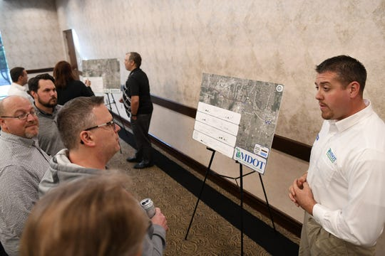 MDOT traffic operations engineer Matt Hickman, right, talks with people at an open house style meeting by MDOT talking about the upcoming I-275 roadwork planned for the spring through fall of 2020. The meeting was at Summit on the Park in Canton, Mich. on Oct. 15, 2019.
