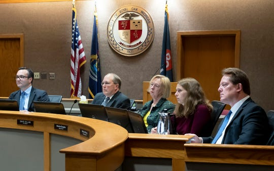Mayor Michael Fournier, left, city attorney David Gillam, Mayor Pro Tem Sharlan Douglas, City Commissioner Melanie Macey, and City Commissioner Randy LeVasseur listen during a Royal Oak City Commission meeting.